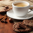Cup of tasty coffee with tasty cookies, on wooden background — Stock Photo #31365199