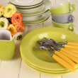 Lots beautiful dishes on wooden table close-up — Stock Photo #31505645