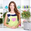 Beautiful girl florist with flowers in flowers shop — Stock Photo #31506633