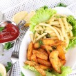 French fries and home potatoes on plate on board on napkin on wooden table — Stock Photo