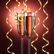 Glasses of champagne and streamer on red background — Stok fotoğraf
