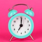 Blue alarm clock on pink background — Stock Photo
