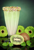 Delicious milk shake on dark green background — Stock Photo