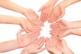 Ring of hands. Conceptual photo of teamwork, isolated on white — Stock Photo