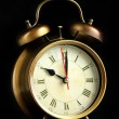Old alarm clock isolated on black — Foto Stock