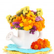 Stock Photo: Bouquet of marigold flowers in watering cisolated on white