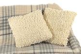 Coloridos cojines en sofá aislado en blanco — Foto de Stock