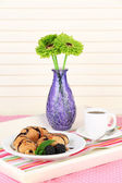 Wooden tray with breakfast, on wooden table, on light background — Stock Photo