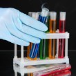 Stock Photo: Laboratory test tubes on black background