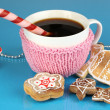 Cup of coffee with Christmas sweetness on blue background — Stock Photo #31547021