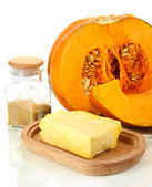 Cut pumpkin with ingredients for cooking isolated on white — Stock Photo