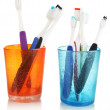 Tooth-brushes in glass isolated on white — Stock Photo