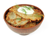 Potato pancakes in bowl, isolated on white — Stock Photo