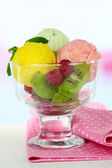 Tasty ice cream scoops, wooden on table — Stock Photo