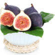Ripe figs in bowl isolated on white — Stock Photo