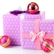 Colorful purple in peas gifts with pink Christmas balls isolated on white — Stock Photo