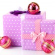 Stock Photo: Colorful purple in peas gifts with pink Christmas balls isolated on white