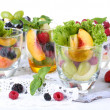 Fruit salad in glasses, isolated on white — Stock fotografie