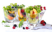 Fruit salad in glasses, isolated on white — Stock Photo