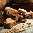 Much bread on wooden board — Stock Photo #31586457