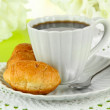 Tasty croissants and cup of coffee on table close-up — Stock Photo #31587291