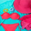 Swimsuit and beach items on bright blue background — Stock Photo #31587763