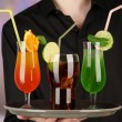 Bartender with different cocktails, close-up — Stock Photo #31591815