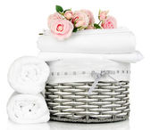 Bedding sheets in wicker basket isolated on white — Stock Photo