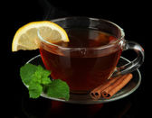 Cup of tea with lemon isolated on black — Stock Photo