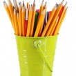 Colorful pencils and other art supplies in pail isolated on white — Stock Photo #31725103