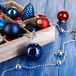 Christmas toys in box on wooden table close-up — Stock Photo #31728335