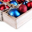 Christmas toys in wooden box isolated on white — Stock Photo