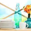 Lots beautiful dishes on wooden shelf on natural background — Stock Photo #31728985