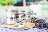 Jar of lavender sugar and fresh lavender flowers on bright background — Stock Photo