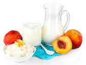 Fresh dairy products with peaches isolated on white — Stock Photo