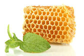 Sweet honeycomb with mint isolated on white — Stock Photo