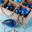 Christmas toys in box on wooden table close-up — Stock Photo