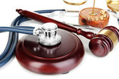 Medicine law concept. Gavel, scales and stethoscope close up — Foto Stock