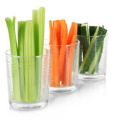 Fresh green celery with vegetables in glasses isolated on white — Stock Photo
