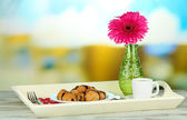 Wooden tray with breakfast, on bright background — Stock Photo