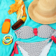 Swimsuit and beach items on bright blue background — Stock Photo #31794695