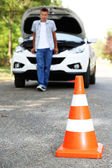 Broken down car with warning cone — Stock Photo
