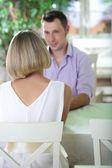 Beautiful couple having romantic date at restaurant — Stock Photo