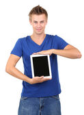 A handsome young man with tablet isolated on white — Stock Photo