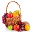 Different fruits in wicker basket isolated on white — Stockfoto