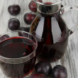 Delicious plum juice on table close-up — Stock Photo #31895753