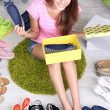 Beautiful girl chooses shoes in room — Stock Photo #31896773