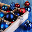 Christmas toys in box on wooden table close-up — Stock Photo #31897565