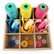 Multicolored skeins of thread and buttons in box isolated on white — Stok fotoğraf