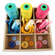 Multicolored skeins of thread and buttons in box isolated on white — Foto de Stock